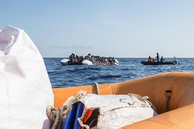Sea Watch-2.<br /> Die Sea Watch-2 bei ihrer 13. SAR-Mission vor der libyschen Kueste.<br /> Im Bild: Ein Schlauchboot mit ca. 160 Menschen wird von der Sea Watch-Crew betreut. Im Vordergrund liegen Schwimmwesten zur Verteilung bereit.<br /> 20.10.2016, Mediterranean Sea<br /> Copyright: Christian-Ditsch.de<br /> [Inhaltsveraendernde Manipulation des Fotos nur nach ausdruecklicher Genehmigung des Fotografen. Vereinbarungen ueber Abtretung von Persoenlichkeitsrechten/Model Release der abgebildeten Person/Personen liegen nicht vor. NO MODEL RELEASE! Nur fuer Redaktionelle Zwecke. Don't publish without copyright Christian-Ditsch.de, Veroeffentlichung nur mit Fotografennennung, sowie gegen Honorar, MwSt. und Beleg. Konto: I N G - D i B a, IBAN DE58500105175400192269, BIC INGDDEFFXXX, Kontakt: post@christian-ditsch.de<br /> Bei der Bearbeitung der Dateiinformationen darf die Urheberkennzeichnung in den EXIF- und  IPTC-Daten nicht entfernt werden, diese sind in digitalen Medien nach &sect;95c UrhG rechtlich geschuetzt. Der Urhebervermerk wird gemaess &sect;13 UrhG verlangt.]