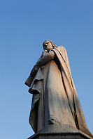 Low angle view of Statue of Dante Alighieri, 1865, by Ugo Zannoni, (1836-1919). Whilst exiled from Florence, the famous Italian poet, Dante, (1265-1321), lived in Verona. This monument was erected to commemorate the 600th anniversary of his birth. Picture by Manuel Cohen.