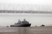 New Orleans, LA - October 13, 2009 -- In this photo provided by the United States Navy, the amphibious transport dock ship Pre-Commissioning Unit (PCU) New York (LPD 21) maneuvers under the New Orleans Crescent City Connection bridge on the Mississippi River Tuesday, October 13, 2009, after departing Northrop Grumman Ship Systems in Avondale, Louisiana. New York has 7.5 tons of steel from the World Trade Center in her bow, and is scheduled to be commissioned November 7 in New York. .Mandatory Credit: John P. Curtis / US Navy via CNP