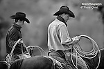 A black and white photo of two cowboys on horse back with ropes. Cowboy Photos, riding,roping,horseback