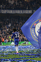 Chelsea's Willian celebrates at the final whistle by walking around the pitch with a very large flag during Chelsea vs Watford, Premier League Football at Stamford Bridge on 15th May 2017