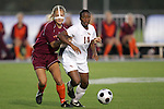 05 November 2008: Florida State's Tiffany McCarty (14) dribbles away from Virginia Tech's Jennifer Harvey (left). Virginia Tech and Florida State University played to a 0-0 tie after two overtimes at Koka Booth Stadium at WakeMed Soccer Park in Cary, NC in a women's ACC tournament quarterfinal game.  Virginia Tech advanced to the semifinal round in penalty kicks, 4-2.