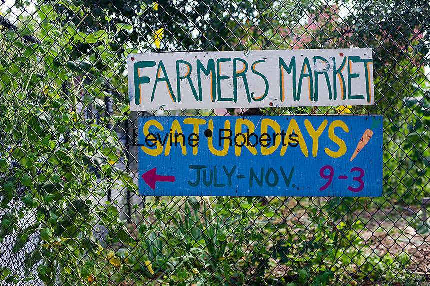 A sign for a Farmers Market seen at the East New York Farms in Brooklyn in New York on Saturday, September 1, 2012. The farm, which had its first season in 1998, promotes local sustainable agriculture with volunteer opportunities,  a Community Supported Agriculture (CSA) program, a farmers' market and a nine month internship program. (© Frances M. Roberts).