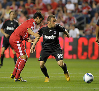 Chicago Fire midfielder Baggio Husidic (9) attempts to hold up AC Milan midfielder Cristian Brocci (88).  AC Milan defeated the Chicago Fire 1-0 at Toyota Park in Bridgeview, IL on May 30, 2010.