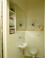 A simple downstairs cloakroom also has some convenient storage space