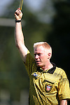 11 September 2005: Referee Paul James issues a yellow card to South Carolina's Greg Reece (not shown) in the first half. The University of North Carolina Tarheels defeated the University of South Carolina Gamecocks 2-0 in an NCAA Divison I men's soccer game at Fetzer Field in Chapel Hill, NC.