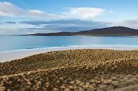 View over dunes towards Taransay island, Luskentyre beach, Isle of Harris, Outer Hebrides, Scotland
