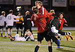 ORIG./Ryan Brennecke/The Bulletin/111312..Mountain View's Curtis Markle (20) jumps into the arms of Mike McClean (16) to celebrate there win over Summit to advance to the State Finals this weekend.