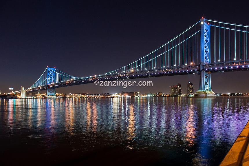 Benjamin Franklin Bridge, reflecting lights on the Delaware River Philadelphia PA,