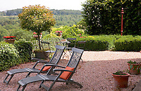 The gravel terrace overlooks fields and trees