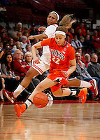 Ohio State's Ameryst Alston (14) is pushed out by Illinois's Ivory Crawford (22) in the first half of their game against the Illinois Fighting Illini at the Value City Arena in Columbus, Ohio on January 30, 2014. (Columbus Dispatch photo by Brooke LaValley)