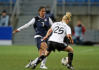 US's Shannon Boxx fights for the ball with Germany's Leonie Maier during their Algarve Women's Cup soccer match at Algarve stadium in Faro, March 13, 2013.  .Paulo Cordeiro/ISI