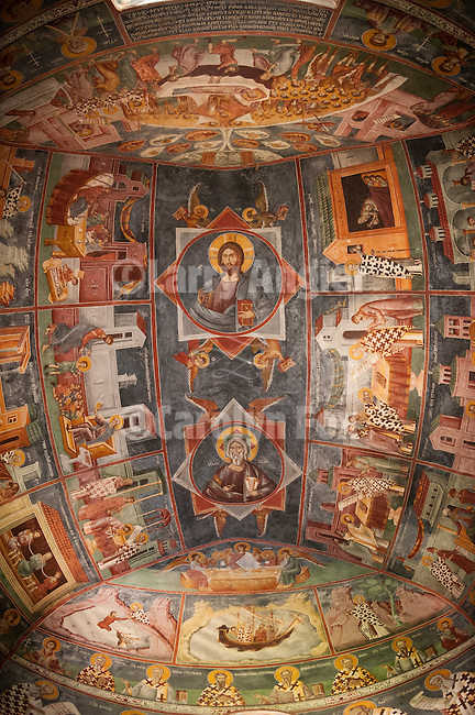 Moraca Monastery, Sinjajevina Mountains, 1252 AD--Church of St. Nicholas with iconography depicting the life of St. Elijah<br /> <br /> Serbian Orthodox monastery located in the valley of the Moraca River in central Montenegro. It is one of the most monumental orthodox Middle Age monuments in Montenegro. It was founded in 1252 by Stefan, son of Vukan Nemanjic, king of Zeta, the grandson of Stefan Nemanja in 1252. This is written above the western portal.<br /> It consists of an assembly church, devoted to the Assumption of Mary, a small church, devoted to Saint Nicola, and a lodgings for travelers. The main door has a high wall which has two entrances. The assembly church is a big one-nave building in the style of Raska churches. It is different from the seaside churches. The main portal is in the romantic style.<br /> Beside the architecture, its paintings are of special importance. There is one painting preserved from the 13th century with 11 compositions from the life of the prophet Elias. This painting is in much better condition than all the others from the 16th century. Other paintings were ruined in the first part of 16th century when the Ottomans occupied the monastery and devastated it. They also carried away the lead roof.