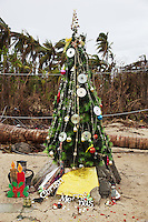 Philippines. Province Eastern Samar. Hernani. Barangay (neighbourhood) Carmel. Christmas tree made with recycled items collected in houses destroyed by typhoon Haiyan's winds and storm surge. Typhoon Haiyan, known as Typhoon Yolanda in the Philippines, was an exceptionally powerful tropical cyclone that devastated the Philippines. Haiyan is also the strongest storm recorded at landfall in terms of wind speed. Typhoon Haiyan's casualties and destructions occured during a powerful storm surge, an offshore rise of water associated with a low pressure weather system. Storm surges are caused primarily by high winds pushing on the ocean's surface. The wind causes the water to pile up higher than the ordinary sea level. 27.11.13 © 2013 Didier Ruef