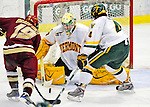 9 January 2009: University of Vermont Catamounts' goaltender Rob Madore, a Freshman from Venetia, PA, makes a third period save during the first game of a weekend series against the Boston College Eagles at Gutterson Fieldhouse in Burlington, Vermont. The Catamounts scored with one second remaining in regulation time to earn a 3-3 tie with the visiting Eagles. Mandatory Photo Credit: Ed Wolfstein Photo