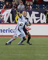 Colorado Rapids forward Conor Casey (9) beats New England Revolution defender Darrius Barnes (25) to the ball.  The Colorado Rapids defeated the New England Revolution, 2-1, at Gillette Stadium on April 24.2010