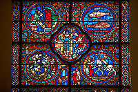Medieval Windows of the Gothic Cathedral of Chartres, France, dedicated to the signs of the Zodiac and the monthly labours.  From bottom left - Wine growers, Bell ringers ( centre bottom) Count Thibault VI on his horse. Above centre is January, the Roman god of Janus  or Aquarius, above left  - February, a man keeping warm in font of a fire, right - two fish representing Pisces. Above left March - A Man pruning the vines and right Aries. Centre panel above - May / Gemini. Above left  is April and top right is Taurus. A UNESCO World Heritage Site.