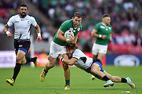 Darren Cave of Ireland takes on the Romania defence Rugby World Cup Pool D match between Ireland and Romania on September 27, 2015 at Wembley Stadium in London, England. Photo by: Patrick Khachfe / Onside Images