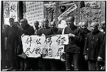 "As part of the monk's self-criticism, they are forced to hold a banner that reads, ""To hell with the Buddhist scriptures. They are full of dog farts."" Harbin, 24 August 1966"