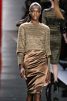 Gaye walks runway in a rustic northwood metallic tweed jacket over chocolate truffle long-sleeved sheath dress with tweed detail, from the Reem Acra Fall 2012 Feminine Power collection fashion show, during Mercedes-Benz Fashion Week New York Fall 2012 at Lincoln Center.