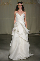 Model walks runway in a Poplar wedding dress by Carol Hannah Whitfield, for the Carol Hannah Spring Summer 2012 Bridal collection runway show.