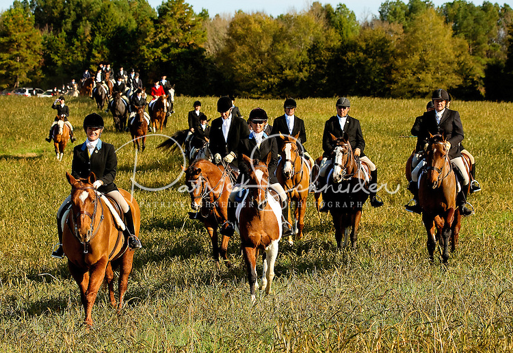 Event photography of the November 2012 annual open meeting of Mecklenburg Hounds, Inc., at which riders attend to the centuries-old traditions of attire, etiquette and hunting procedure. The 2012 opening meet was held in Monroe, NC..Mecklenburg Hounds is one of about 165 recognized hunts of the Masters of Foxhounds Association of North America.
