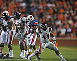 Ole Miss' Serderius Bryant (14) celebrates a tackle at Jordan-Hare Stadium in Auburn, Ala. on Saturday, October 29, 2011. .