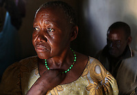 Sayi Mwandu, 56, who had part of her hand cut off by fellow villagers, stands in the doorway of her room in Kolandoto, a protective institution in Shinyanga, Tanzania. Mwandu was accused of being a witch after her eyes turned red from over-exposure to smoke from cooking fires. Mwandu is not alone in her victimization. Older women in many parts of the world, including Tanzania, are still persecuted and accused of witchcraft.  Many are killed.  Often, the accusations are an attempt to oust the woman from property the accusers hope to gain access to.