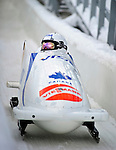 18 December 2010: Mellissa These crosses the finish line, finishing in 13th place for Canada at the Viessmann FIBT World Cup Bobsled Championships on Mount Van Hoevenberg in Lake Placid, New York, USA. Mandatory Credit: Ed Wolfstein Photo