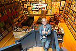 Thomas Lauderdale of the famed band Pink Martini at his home in Portland, Oregon, surrounded by his collections.