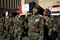 Army colleagues carry the coffin of Adjutant Marin Saleh Ahmad of the Syrian army at his funeral in Damascus. He was shot in the chest by a sniper in the eastern suburbs of the city.Protests against the ruling Baathist regime of Bashar al-Assad erupted in March 2011. Although they were initially peaceful,  they were violently repressed by the Syrian army and police. In response to being ordered to shoot unarmed civilians, large numbers of men deserted the army and formed the Free Syrian Army. The protest movement has now turned into an armed uprising with clashes between the regular army and the Free Syrian Army taking place in early 2012..