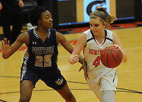 NWA Democrat-Gazette/FLIP PUTTHOFF <br />  Tiya Douglas (25) defends for the Lady Bulldogs against Faith Rohrbough (4) moving down court for the Lady War Eagles.