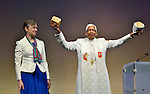 United Methodist Bishop Violet Fisher (right) leads a service of communion at the United Methodist Women's Assembly during an April 27, 2014 worship service at the Kentucky International Convention Center in Louisville, Kentucky. On the left is Harriett Olson, top executive of the women's organization.