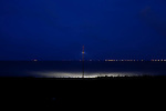 A light provided for night-fishing illuminates Galveston Bay near the Texas City Dike.