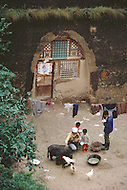 September, 1985. Shaanxi Province, China. The caves of Yan'an are more than 500 years old and still provide shelter for the farmers.