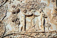 Bas-relief sculpture panel scene of Eve giving Adam an apple by Maitani around 1310 on the14th century Tuscan Gothic style facade of the Cathedral of Orvieto, Umbria, Italy