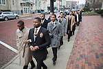 Brothers of Alpha Phi Alpha Fraternity Inc. lead the Martin Luther King Jr. Silent March down Court Street on Jan. 16, 2017.