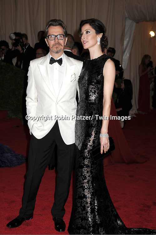 "Gary Oldham and wife attends the Costume Institute Gala Benefit celebrating ""Schiaparelli and Prada: Impossible Conversations"".an exhibition at the Metropolitan Museum of Art in New York City on May 7, 2012."