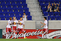 John Wolyniec (15) of the New York Red Bulls celebrates scoring with teammates during a U. S. Open qualifier match against the Colorado Rapids at Red Bull Arena in Harrison, NJ, on May 26, 2010.