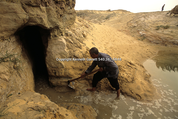 Water flows from a qanat (ancient aquaduct) at Ain el-Labekha, ; Roman fort, Darb el-Arbaein, trade route; Egypt; Archaeologist; Salima Ikram; Kharga Oasis;Ancient Cultures; mm7195; Desert; Oasis