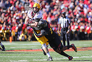 College Park, MD - October 15, 2016: Minnesota Golden Gophers tight end Brandon Lingen (86) is tackled by Maryland Terrapins linebacker Jermaine Carter Jr. (23)during game between Minnesota and Maryland at  Capital One Field at Maryland Stadium in College Park, MD.  (Photo by Elliott Brown/Media Images International)