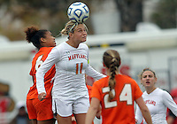 COLLEGE PARK, MD - OCTOBER 28, 2012:  Olivia Wagner (11) of the University of Maryland wins a header against Jordan Roseboro (6) of Miami during an ACC  women's tournament 1st. round match at Ludwig Field in College Park, MD. on October 28. Maryland won 2-1 on a golden goal in extra time.