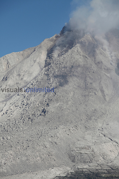 Large andesitic lava flow deposit on flank of Sinabung Volcano, Sumatra, Indonesia. Note the farmland at bottom.