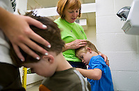 Lissa Riley, a special needs teacher at Beacon School in Athens, Ohio, dries the hair of Danny Caroll, 7, after a swim lesson on Oct. 3, 2008. Riley, 55, has been teaching at Beacon for 17 years. .
