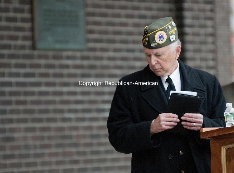 TORRINGTON, CT - 09 NOV 2014 -- Roger O. Geiger, of Torrington, a Vietnam era veteran, leaves the poduim in Coe Memorial Park Tuesday after giving the benediction closing a Veterans' Day observance. Alec Johnson/ Republican-American