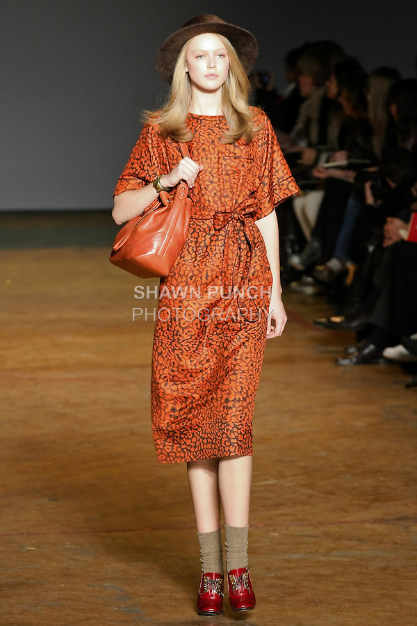 Frida Gustavsson walks runway in a woodchuck brown multi jungle silk dress, merlot voyage drawstring bag, and bordeaux patent leather lace up oxfords, from the Marc by Marc Jacobs Fall/Winter 2011 collection, during New York Fashion Week, Fall 2011.