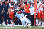 19 September 2015: Illinois' Marchie Murdock (16) is tackled by UNC's Donnie Miles (15). The University of North Carolina Tar Heels hosted the University of Illinois Fighting Illini at Kenan Memorial Stadium in Chapel Hill, North Carolina in a 2015 NCAA Division I College Football game. UNC won the game 48-14.