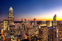 Close-in photography of the Charlotte NC skyline, taken at sunset (series of images shows sky changing colors as the sun falls below the horizon). Image includes the new Duke Energy Tower (shown far right).