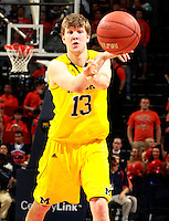 CHARLOTTESVILLE, VA- NOVEMBER 29: Matt Vogrich #13 of the Michigan Wolverines handles the ball during the game on November 29, 2011 at the John Paul Jones Arena in Charlottesville, Virginia. Virginia defeated Michigan 70-58. (Photo by Andrew Shurtleff/Getty Images) *** Local Caption *** Matt Vogrich