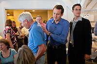Republican presidential hopeful Tim Pawlenty, center, campaigns on Tuesday, July 26, 2011 in Ottumwa, IA.